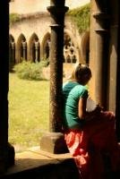 Jess takes a quiet moment to journal in a cathedral's cloister.